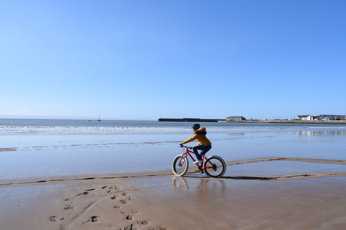 cyclist on beach porthcawl