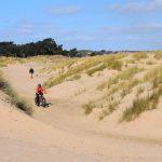 cyclist on sand dunes