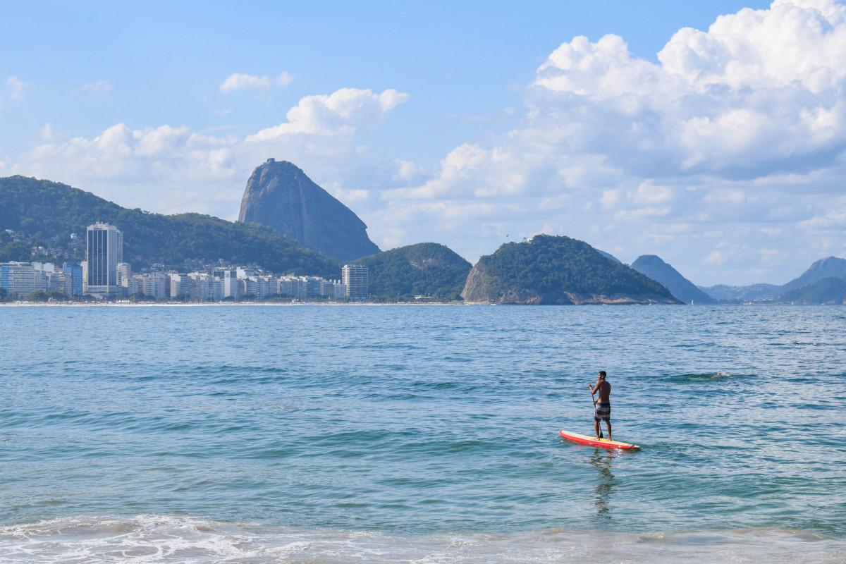 surfer at Copacabana beach rio de janeiro brazil