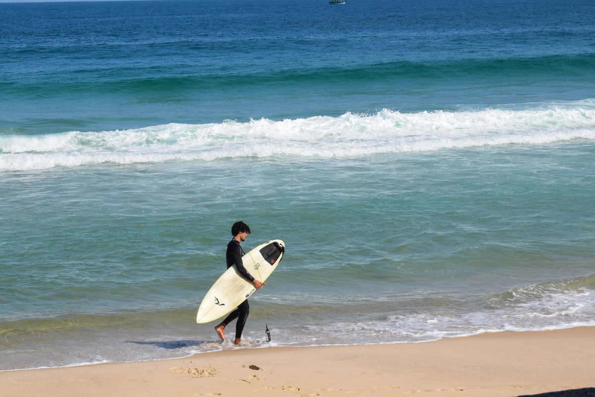 surfer at Ipanema beach Rio de Janeiro Brazil